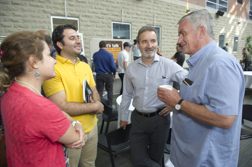 Group of scientists having a conversation